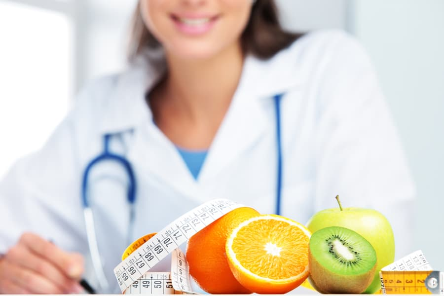 close up of fruit infront of a doctor