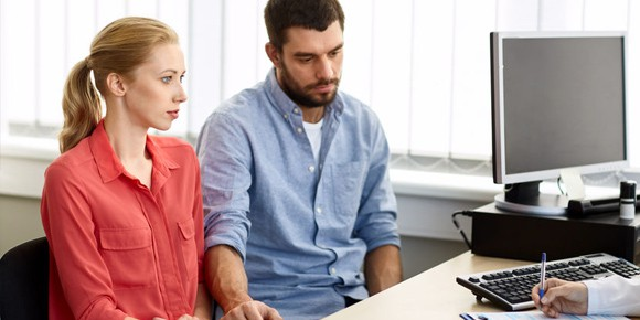 Couple seated in office