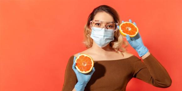 Woman holding grapefruit halves